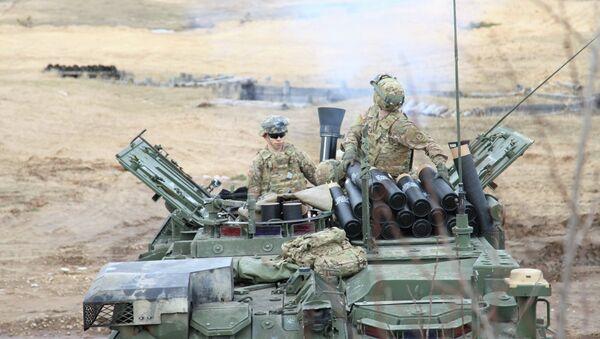 Militares de EEUU durante los ejercicios en Letonia - Sputnik Mundo