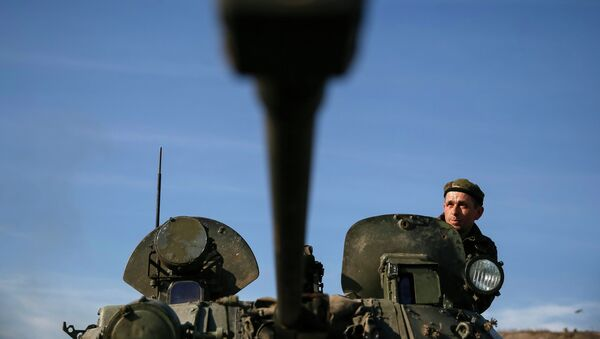 A Ukrainian soldier looks out from an armoured vehicle at a position near Kurakhovo, not far from Donetsk March 11, 2015. - Sputnik Mundo