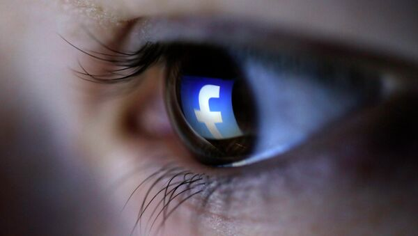A picture illustration shows a Facebook logo reflected in a person's eye, in Zenica, March 13, 2015 - Sputnik Mundo