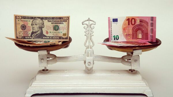U.S. Dollar and Euro banknotes on a pair of scales in Vienna are seen in this March 11, 2015 file photo - Sputnik Mundo