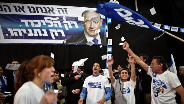 Likud party supporters react after hearing exit poll results in Tel Aviv March 17, 2015. - Sputnik Mundo