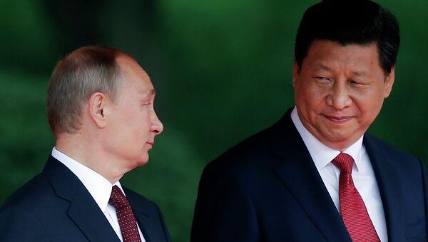 Vladímir Putin, presidente de Rusia, y Xi Jinping, presidente de China (Archivo) - Sputnik Mundo