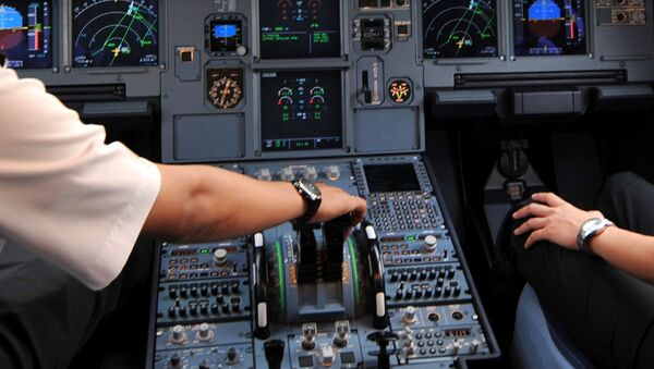 Pilots in the cockpit of an Airbus A320 at Cengkareng airport in Jakarta. File photo - Sputnik Mundo