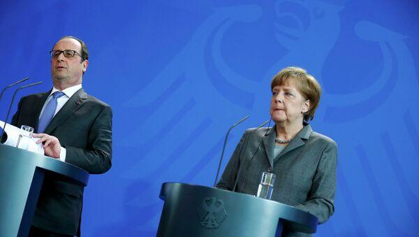 François Hollande, presidente de Francia y Angela Merkel, canciller de Alemania - Sputnik Mundo