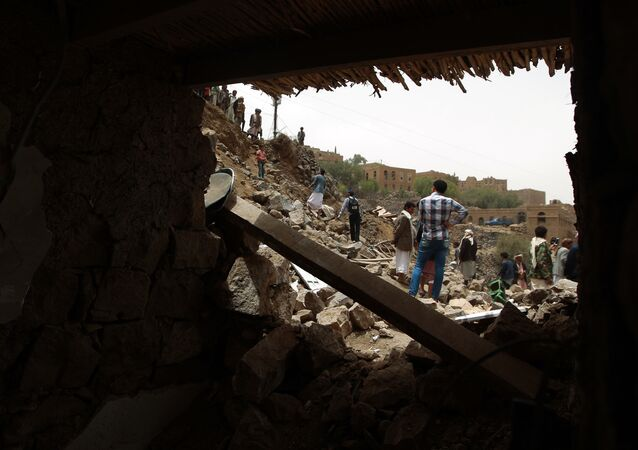 Yemenis inspect the rubble of destroyed houses in the village of Bani Matar, 70 kilometers (43 miles) West of Sanaa, on April 4, 2015