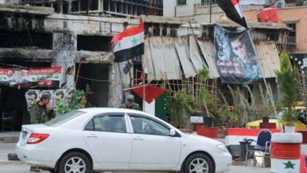 Блокпост сирийской армии на одной из улиц в центре Хомса - Sputnik Mundo