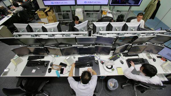 Policía japonesa detecta un nuevo virus que permitió robar unos 24 millones de dólares - Sputnik Mundo