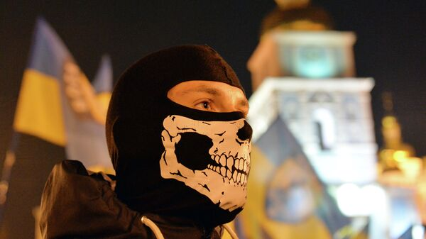 A man takes part in a march in Kiev on October 14, 2014 to mark the founding of the Ukrainian Insurgent Army (UPA) - Sputnik Mundo