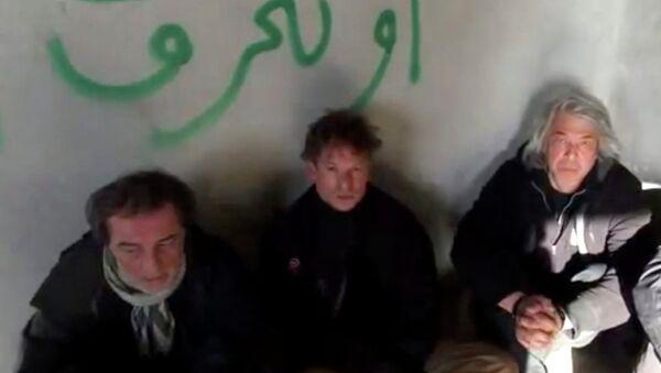 Aziz Akyavas, Richard Engel y John Kooistra - Sputnik Mundo