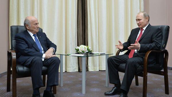 Presidente de la FIFA, Joseph Blatter y presidente de Rusia, Vladímir Putin - Sputnik Mundo
