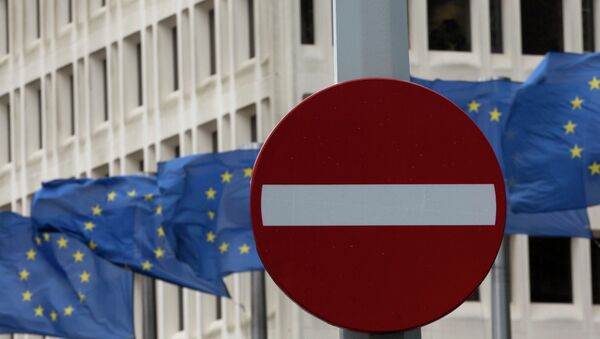 EU flags flap in the wind behind a no entry traffic sign in front of EU headquarters in Brussels. - Sputnik Mundo