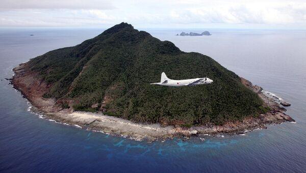 Una de las islas Senkaku (Diaoyu) - Sputnik Mundo