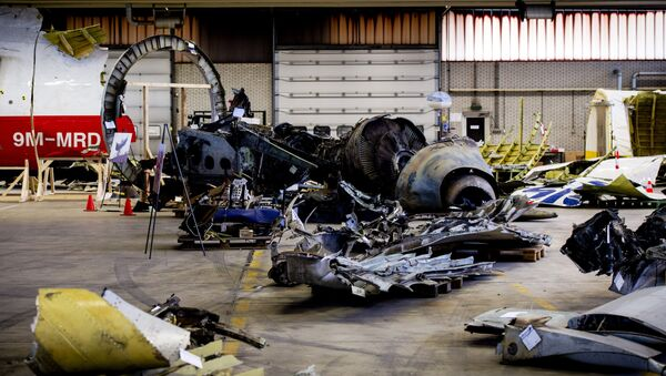 The wreckage of the Malaysia Airlines flight MH17 which was shot down over Ukraine in July 2014, laid out in a hangar on Gilze-Rijen airbase in the southern Netherlands. - Sputnik Mundo