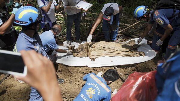 Uno de los cuerpos hallados en Tailandia - Sputnik Mundo