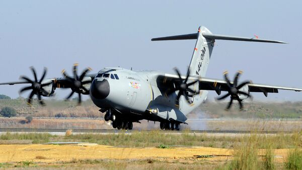 A file picture taken on December 11, 2009 shows an Airbus A400M military transporter landing in Sevilla - Sputnik Mundo