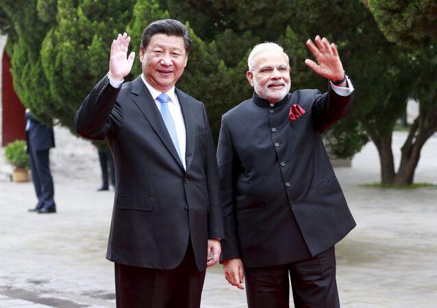 Presidente de China, Xi Jinping, y primer ministro de India, Narendra Modi