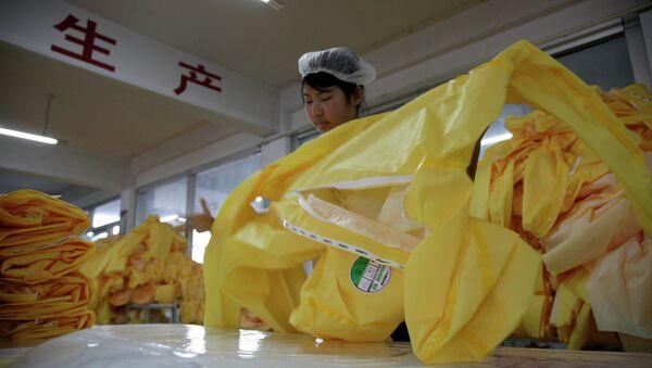 Una fábrica en China - Sputnik Mundo