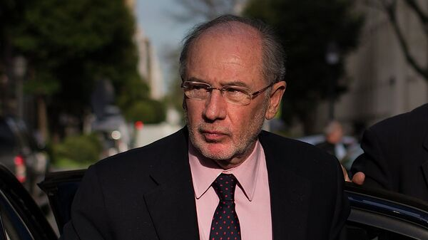 Former Finance Minister and International Monetary Fund chief Rodrigo Rato arrives at his apartment in Madrid, Spain, Monday, April 20, 2015. - Sputnik Mundo