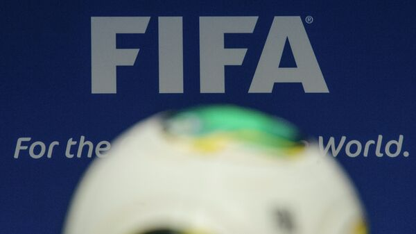 The FIFA logo is pictured behind a ball during the press conference following the meeting of the FIFA executive comittee in Zurich - Sputnik Mundo