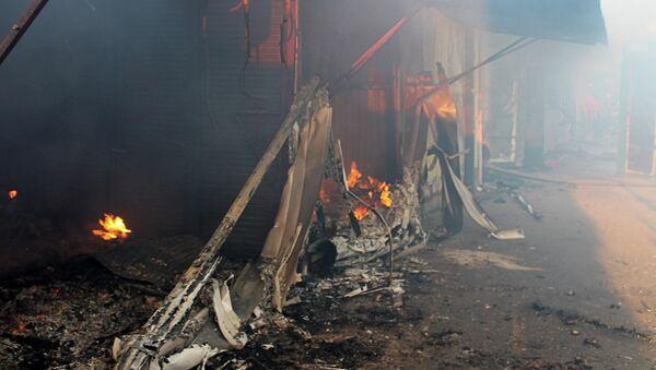 Bombardeos en el poblado de la mina Oktiábrskaia, en Donetsk - Sputnik Mundo