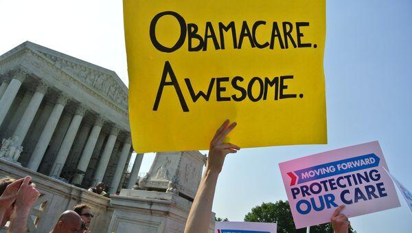 Protesta en favor de Obamacare - Sputnik Mundo