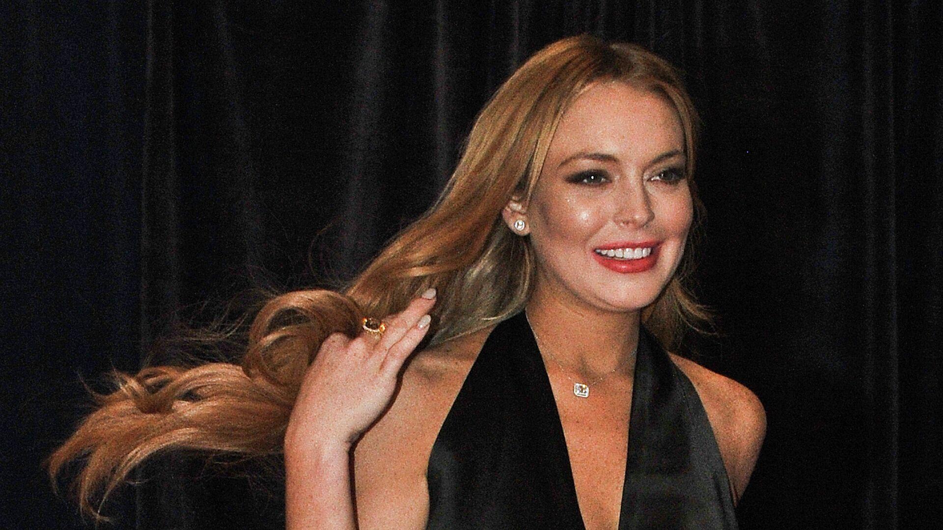 US actress Lindsay Lohan arrive at the annual White House Correspondents' Association dinner in Washington on April 28, 2012.  - Sputnik Mundo, 1920, 24.02.2021