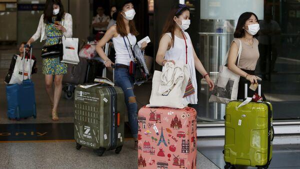 Turistas de Corea del Sur en el aeropuerto de Hong Kong - Sputnik Mundo