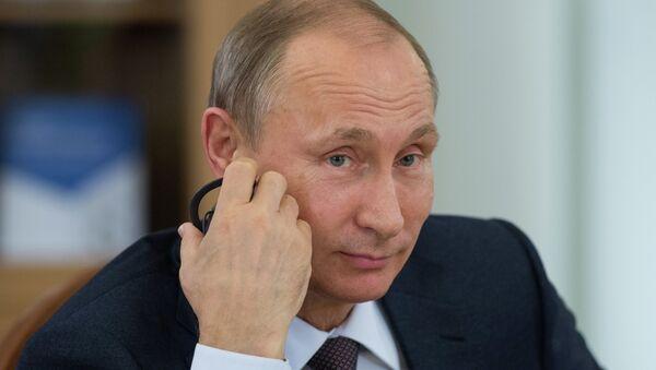 El presidente de Rusia, Vladimir Putin, durante una reunión con los líderes de las agencias de noticias más importantes del mundo - Sputnik Mundo