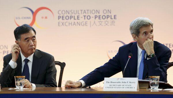 Viceprimer ministro de China, Wang Yang, y Secretario de Estado de EEUU, John Kerry - Sputnik Mundo