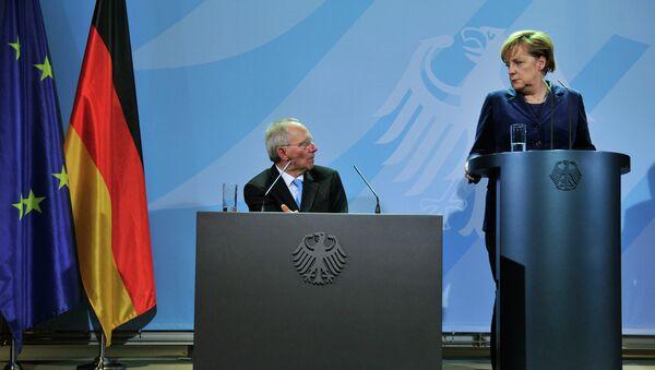 Ministro de Finanzas de Alemania, Wolfgang Schauble y canciller de Alemania Angela Merkel - Sputnik Mundo