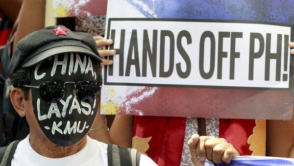 Protesta en contra de la actividad de China en el Mar del Sur de China, Manila, Filipinas, el 7 de julio, 2015 - Sputnik Mundo