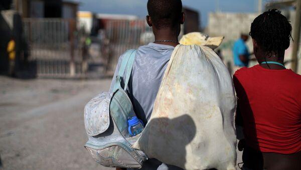 Migrantes haitianos - Sputnik Mundo