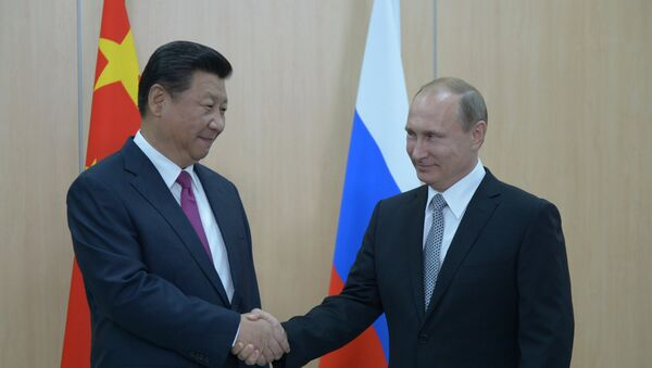 Xi Jinping, presidente de China, y Vladímir Putin, presidente de Rusia - Sputnik Mundo