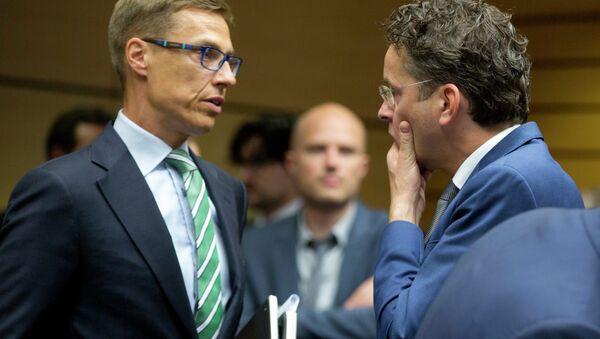 El ministro de Finanzas de Finlandia, Alexander Stubb (izquierda) y el presidente del Eurogrupo, Jeroen Dijsselbloem - Sputnik Mundo