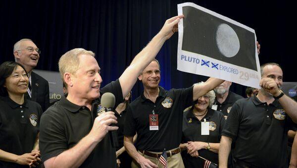 NASA celebra el acercamiento de la sonda New Horizons a Plutón, el 14 de julio, 2015 - Sputnik Mundo