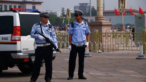 Policías chinos - Sputnik Mundo