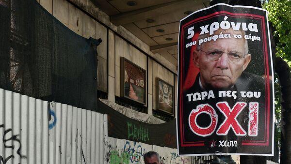 Póster con la imágen de Wolfgang Schäuble en Atenas - Sputnik Mundo