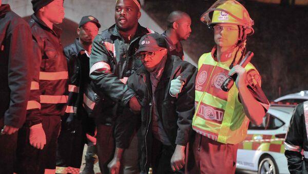 Un pasajero herido en la estación Booyseens, Johannesburgo - Sputnik Mundo