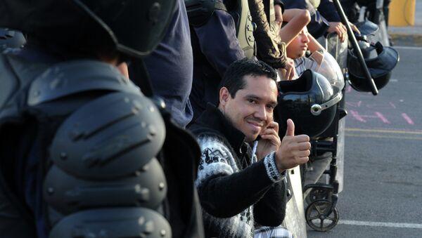 Un miembro del movimiento hondureño de oposición indignada, Ariel Varela - Sputnik Mundo