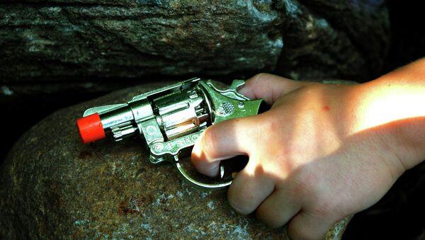 Pistola de juguete - Sputnik Mundo