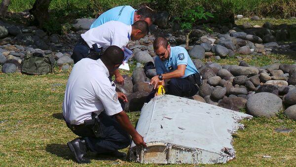 Fragmento hallado es del MH370 - Sputnik Mundo