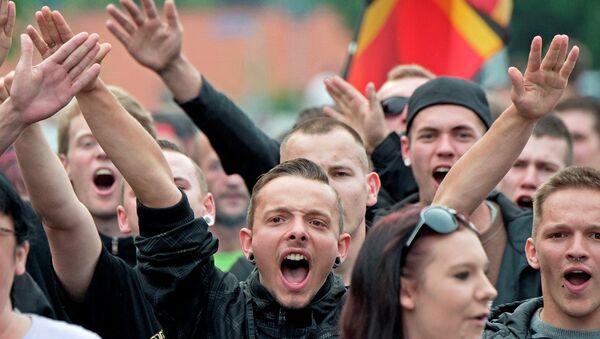 Manifestantes protestan contra alojamiento de migrantes en Alemania - Sputnik Mundo