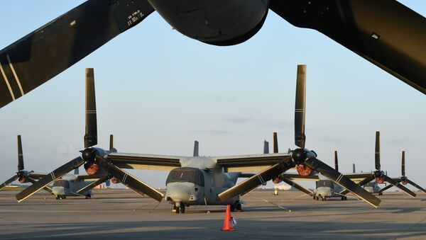 Multi-mission tiltrotor Osprey aircraft at the US Marine's Camp Futenma in a crowded urban area of Ginowan, Okinawa prefecture - Sputnik Mundo