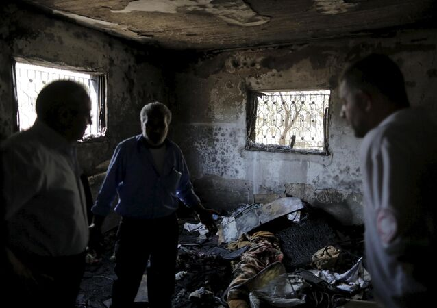 Casa encendida por los terroristas judíos cerca de la ciudad de Nablus, el 31 de julio, 2015