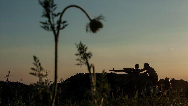 La línea de frente en el pueblo de Krymske, al este de Ucrania - Sputnik Mundo