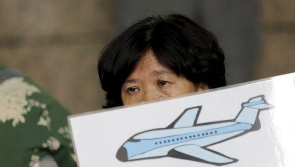 Familiares de los pasajeros del vuelo MH370 - Sputnik Mundo
