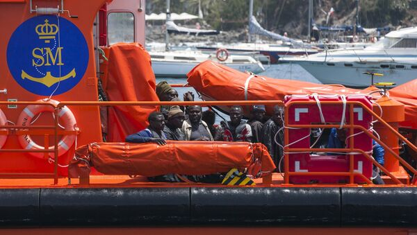African migrants rest on board a Spanish rescue boat after arriving at Arguineguin port in the Canary Island Gran Canaria, Spain - Sputnik Mundo