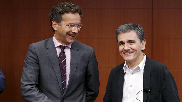 Presidente del Eurogrupo, Jeroen Dijsselbloem, y ministro de Finanzas de Grecia, Euclides Tsakalotos - Sputnik Mundo
