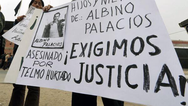 Familiares de víctimas de masacre de Accomarca durante una manifestación - Sputnik Mundo