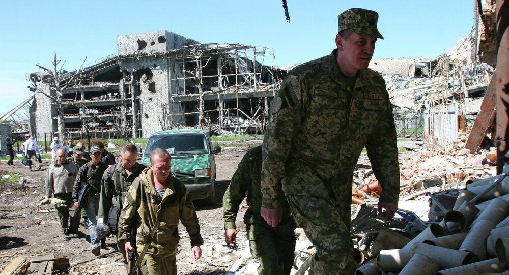 Milicianos de Donbás y representantes de Ejército de Ucrania